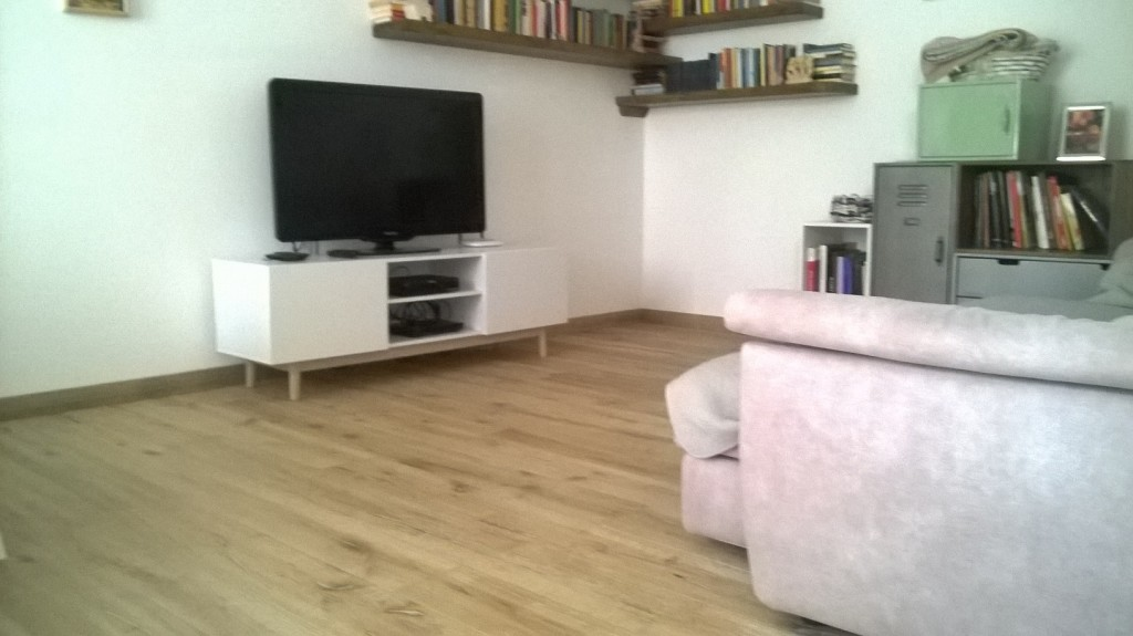 Ristrutturazione di una casa anni con mix di materiali